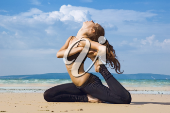 Royalty Free Photo of a Woman Stretching on the Beach