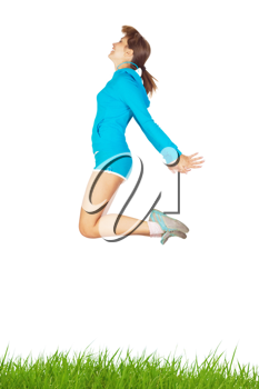 Royalty Free Photo of a Woman Jumping Over the Grass