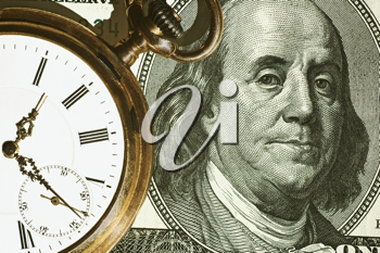 Time and Money concept image.us currency and a pocket watch portray time and money.Business concept.