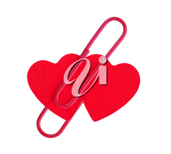 two red hearts pinned together isolated on white background
