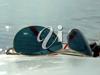Royalty Free Photo of Sunglasses With Water in the Background