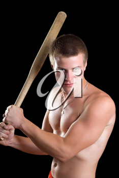 Royalty Free Photo of a Shirtless Man With a Bat