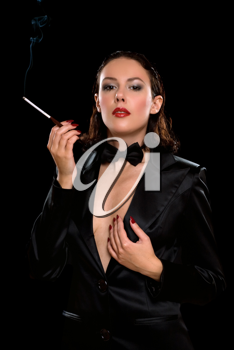 Royalty Free Photo of a Woman With a Cigarette Holder