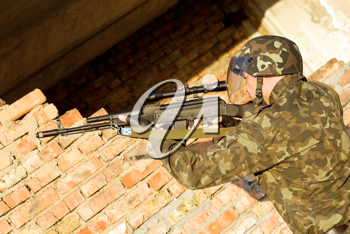 Royalty Free Photo of a Soldier Firing a Gun
