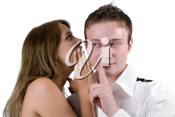 Royalty Free Photo of a Woman Whispering in a Man's Ear