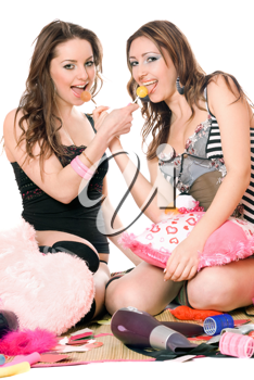 Royalty Free Photo of Two Young Women Sharing Candy
