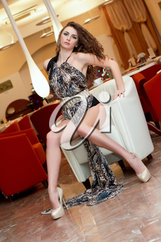 Sensual sexy young woman in a restaurant