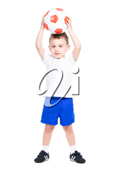 Nice little boy posing with a soccer ball. Isolated on white
