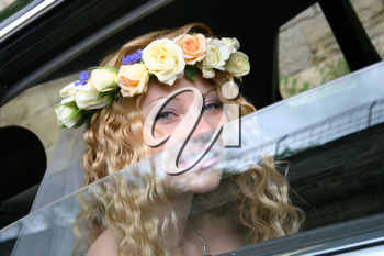 Royalty Free Photo of a Bride Sitting in a Vehicle