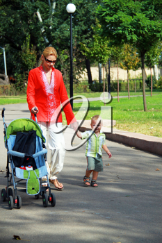 Royalty Free Photo of a Mother and Son Walking Outside