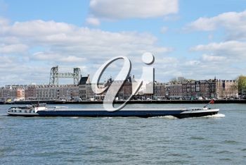 Barge on  backdrop of  waterfront of Rotterdam. Netherlands
