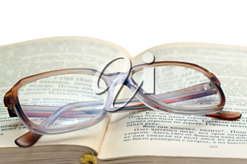 Royalty Free Photo of Reading Glasses on a Book