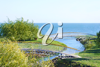 Royalty Free Photo of a Pedestrian Bridge Over a River