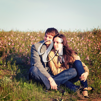Outdoor Portrait of young couple against the sky