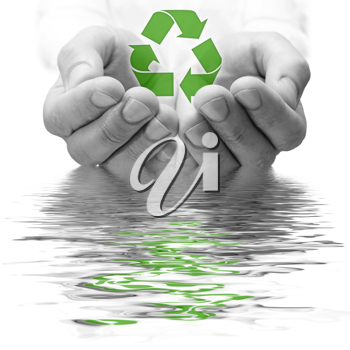 Royalty Free Photo of a Hand Holding a Recycling Symbol