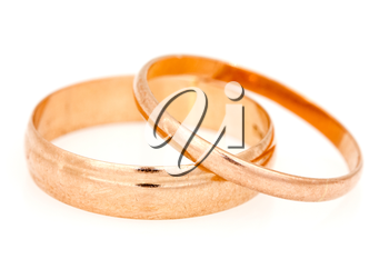 Golden wedding rings on a white background