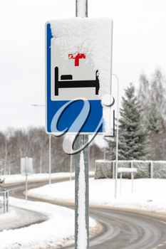 Hospital sign  on the road for show that there is a hospital infirmary or clinic in front
