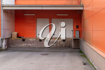 Storage door for unloading cargo, can be used as industrial background. Cargo Doors at Warehouse or Shop Loading Bay