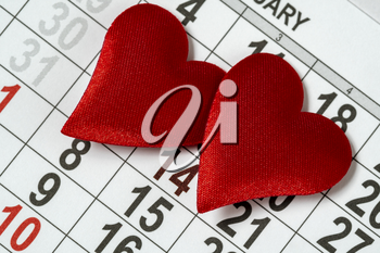 Valentine's day background, February 14 on the calendar with two red hearts