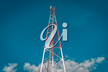 Low angle view of telecommunication tower against sky background