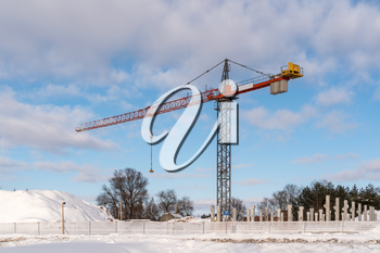 Construction site with a tower crane. Construction of multi-storey building in winter