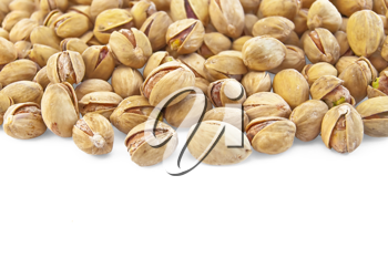 A pile of salted pistachios isolated on a white background