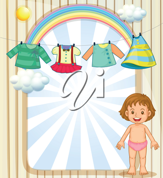 Illustration of a baby below the hanging clothes