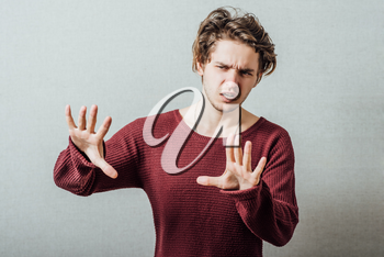 A man shows the hands stop timeout. On a gray background.