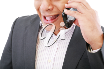 angry young male executive yelling on his mobile phone against white background