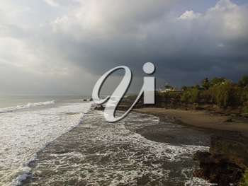 Tanah Lot sunset in stormy weather, Bali, Indonesia