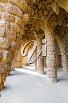Famous stone colonnade in Parc Guell, Barcelona, Spain.