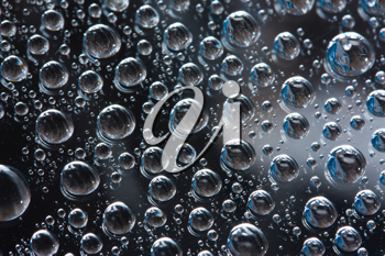 Royalty Free Photo of a Closeup of Water Drops on a Smooth Surface