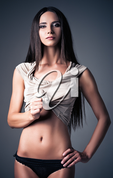 Studio fashion shot of a sexy young girl in shirt and panties