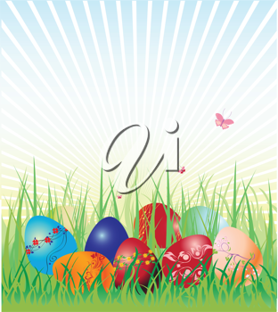 Royalty Free Clipart Image of Easter Eggs on Grass