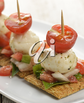 Healthy Crackers With Mozzarella Cheese And Tomatoes