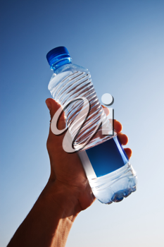 Human hand holding a big bottle of water