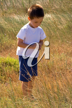 Vintage picture of a young child in nature