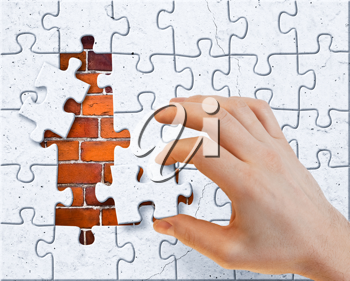 Royalty Free Photo of a Person Doing a Puzzle