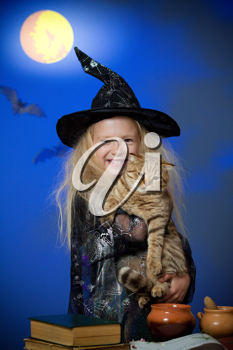 Royalty Free Photo of a Girl Dressed as a Witch With a Cat