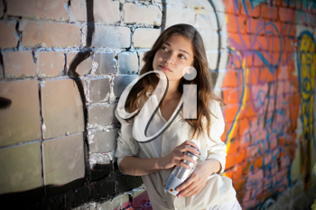 Royalty Free Photo of a Teenage Girl Spray Painting