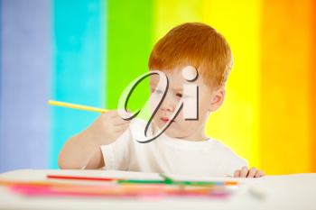 Royalty Free Photo of a Little Boy Drawing