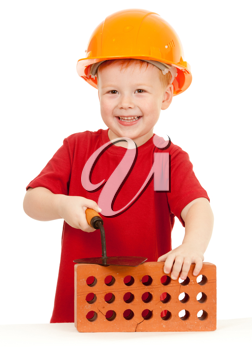 Royalty Free Photo of a Little Boy With a Brick