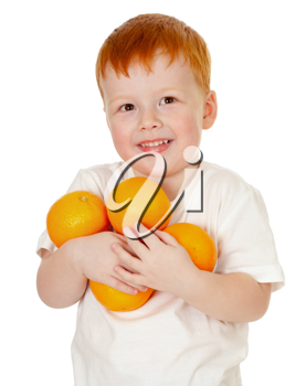 Royalty Free Photo of a Little Boy Holding Oranges