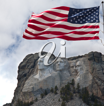 Royalty Free Photo of Mount Rushmore and American Flag
