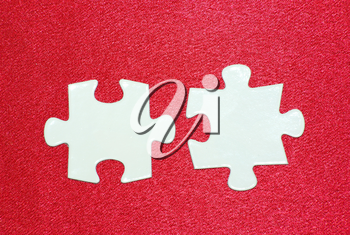 White puzzles isolated on a red