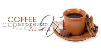 Closeup shot of freshly prepared cup of italian espresso with cinnamon and candy over white background