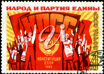 USSR - CIRCA 1977: A stamp printed in the USSR, shows a group of people at a rally meeting, the inscription people and the party united, Party, constitution of the USSR in 1977 , circa 1977