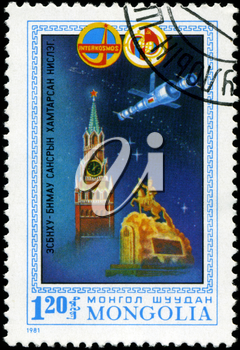 MONGOLIA- CIRCA 1981: A stamp printed in Mongolia shows Spaceship, Kremlin and monument in Ulanbaator, stamp from series honoring Intercocmos program, circa 1981.