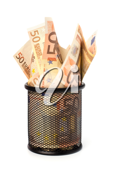 Waste of money concept. Euro currency in garbage bin isolated on white background.
