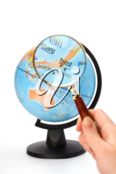Japan map. Hand holding magnifying glass over earth globe Japan territory.